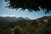 Landscape view from the town on 13th September 2017 in Evisa, Corsica, France. Evisa is a central location for walkers who come to walk to the Gorges de Spelunca which are below in the distance. Corsica is an island in the Mediterranean and one of the 18 regions of France. It is located southeast of the French mainland and west of the Italian Peninsula.
