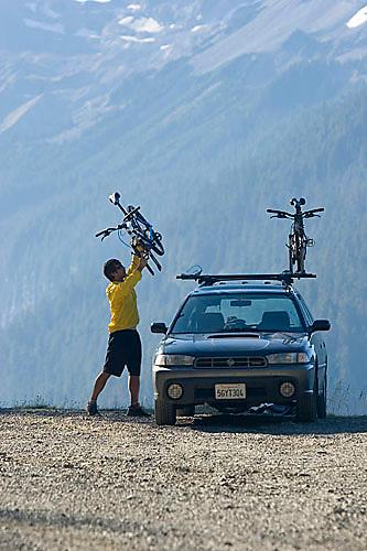 Young man mountain biking in Mount Rainier National Park, WA.<br />