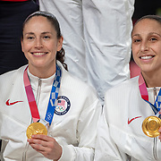 TOKYO, JAPAN August 8:  Five-time Olympic gold medalists Sue Bird #6 of the United States and Diana Taurasi #12 of the United States with their gold medals at the presentation ceremony after the team victory during the Japan V USA basketball final for women at the Saitama Super Arena during the Tokyo 2020 Summer Olympic Games on August 8, 2021 in Tokyo, Japan. (Photo by Tim Clayton/Corbis via Getty Images)