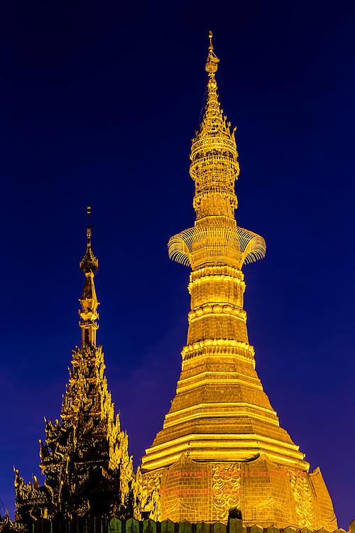 Golden Pagoda: Golden Sule Pagoda is set in stark contrast to the deep blue sky of dusk, Yangon Myanmar.