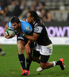Odwa Ndungane of the Sharks tackles Duncan Matthews during the Currie Cup match between the The Sharks and The Blue Bulls held at King's Park, Durban, South Africa on the 27th August 2016<br /> <br /> Photo by:   Anesh Debiky / Real Time Images