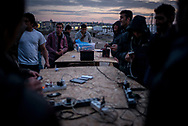 Migrants are seen recharging their phones in a makeshift camp in the train station wearhouses. March 16th 2017, Belgrade, Serbia. Federico Scoppa