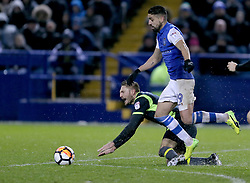 Carlisle united's Danny Grainger tackles Sheffield Wednesday's Marco Matias