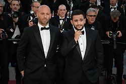 Malik Bentalha and Franck Gastambide attending the premiere of the film Les Filles du Soleil during the 71st Cannes Film Festival in Cannes, France on May 12, 2018. Photo by Julien Zannoni/APS-Medias/ABACAPRESS.COM