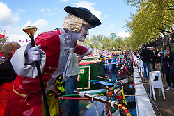 """Little Venice, London, May 3rd 2015. After a dull, damp start to the day, hundreds of Londoners and narrowboat enthusiasts arrive at Paddington Basin at the juction of the Regents and the Grand Union Canals for the annual Inland Waterways Association's Canalway Cavalcade, celebrating the history and traditions of Britains vast network of canals and navigable rivers. PICTURED:  """"Living Statue"""" Michelle Tam poses for phghotographs aboard one of the canal boats"""