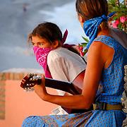 Masked musicians, muzzled music, muzzed artists, street, street music, guitar, portrait, people