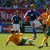 Photo: Glyn Thomas.<br />Australia v Japan. Group F, FIFA World Cup 2006. 12/06/2006.<br />Japan's Alessandro Santos (R) is tackled by Scott Chipperfield.