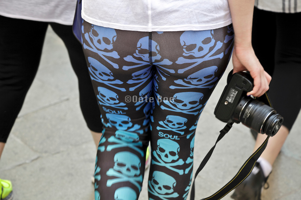 rear view of female person wearing a stretch pants with deadheads