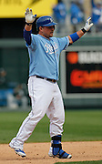 Kansas City Royals' Billy Butler celebrates after hitting a 2 RBI double in the ninth inning of a baseball game to to tie the game against the Chicago White Sox at Kauffman Stadium in Kansas City, Mo., Sunday, May 5, 2013.  (AP Photo/Colin E. Braley).