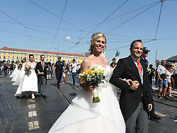 LISBON, June 13, 2017  Newly-wed couples take part in a group wedding in Lisbon, capital of Portugal, on June 12, 2017. A total of 11 couples got married during a group wedding in Lisbon on Monday as part of the month-long Lisbon Festival.  zxj) (Credit Image: © Zhang Liyun/Xinhua via ZUMA Wire)