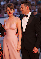 Actress Dakota Johnson, director Scott Cooper at the gala screening for the film Black Mass at the 72nd Venice Film Festival, Friday September 4th 2015, Venice Lido, Italy.