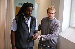 Mental health patient being escorted by a carer,