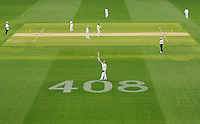 Steve Smith of Australia celebrates his century next to the number 408 displayed as a tribute to the late Phillip Hughes who was the 408th test player for Australia, during day two of the First Test match between Australia and India at Adelaide Oval on December 10, 2014. (Copyright Michael Dodge/Getty Images)