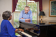 Active Seniors Singing and Playing Piano
