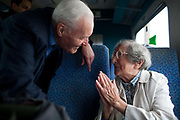 """Tony Benn MP on the peace train to Manchester, UK in 2006 with Stop the War Coalition, stops to talk to Hattie, who is 100 years old and going strong. Anthony Neil Wedgwood """"Tony"""" Benn, (3 April 1925 – 14 March 2014), formerly 2nd Viscount Stansgate, was a British Labour Party politician who was a Member of Parliament (MP) for 50 years and a Cabinet Minister."""