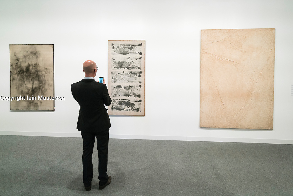 Modern paintings  on display at Abu Dhabi Art , modern art fair, held on Saadiyat Island , Abu Dhabi in November 2015 , United Arab Emirates