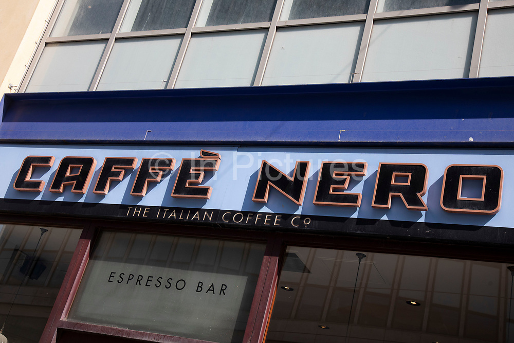 Sign for the coffee shop and brand Caffe Nero in Birmingham, United Kingdom.