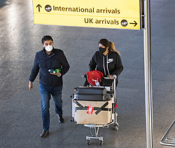 © Licensed to London News Pictures. 15/02/2021. London, UK. Travellers arrive at Heathrow Airport, Terminal 2 in London. New quarantine measures being introduced from today mean that any travellers form red list countries will be required to isolate for ten days in a hotel at a cost of £1,750 per person.  Photo credit: Ben Cawthra/LNP