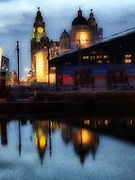 The Liverpool's docks in Liverpool, England. It was one of Liverpool's greatest contributions to progress in world trade and commerce. Liverpool is a city and seaport, northwestern England. Original home of the Beatles, The Merseyside Maritime Museum, International Slavery Museum and the Titanic was also built in the Liverpool shipyards.