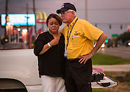 A Police chaplian from Dallas comforts a woman at a makeshift memorial for the  officers that were killed in Baton Rouge at a   B-Quik gas station.