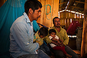El CALVARIO, MEXICO - AUGUST 4, 2015: Jose Luis Garcia, 28, and his family inside of his house in the community of El Calvario. This village is located nearby to Chilpancingo city, the capital of the state of Guerrero, and almost all its population work in the sowing of opium poppy as unique way to survive economically.  Rodrigo Cruz for The New York Times