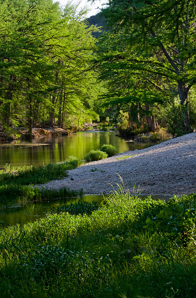 Stock photo of a quiet shaded section of the Frio River in the Texas Hill Country