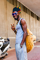 Man with a lion stuffed animal on his back as a fashion accessory, in the hip urban neighborhood of Maboneng Precinct, Johannesburg, South Africa.