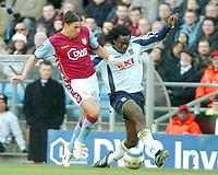 Photo: Ed Godden.<br />Aston Villa v Portsmouth. The Barclays Premiership. 04/03/2006. <br />Milan Baros (R) challenges Portsmouth's Linvoy Primus.