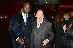 Left to right, OZWALD BOATENG and STEPHEN JONES at a dinner hosted by Liberatum to honour Francis Ford Coppola held at the Bulgari Hotel & Residences, 171 Knightsbridge, London on 17th November 2014.