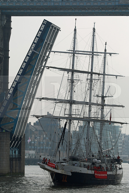 © Licensed to London News Pictures. 19/09/2014.  The tall ship Lord Nelson has arrived back in the UK after completing the 50,000 nautical mile Norton Rose Fulbright Sail the World Challenge. She passed through Tower Bridge this morning and moored alongside HMS Belfast where she received a rousing welcome from the Royal Marines Band. Lord Nelson was accompanied up the river by her sister ship Tenacious. Both vessels are accessible for able bodied and disabled sailors and are owned by the Jubilee Sailing Trust charity. JST was named as the National Lottery's 2014 Sports Charity of the Year. Credit : Rob Powell/LNP