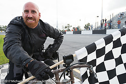 EBay Jake with the checkered flag after taking first place at Billy Lane's Sons of Speed vintage motorcycle racing during Biketoberfest. Daytona Beach, FL, USA. Saturday October 21, 2017. Photography ©2017 Michael Lichter.