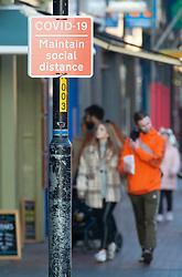 © Licensed to London News Pictures 09/01/2021.         Tonbridge, UK. A Covid19 social distancing sign in Tonbridge High Street in Kent this afternoon. The Coronavirus infection rate in Kent continues to rise as the mutant strain spreads across the county. Photo credit:Grant Falvey/LNP