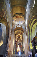Pictures & images of the interior main aisle and apse fresco depicting Christ Pantocrator. The Eastern Orthodox Georgian Svetitskhoveli Cathedral (Cathedral of the Living Pillar) , Mtskheta, Georgia (country). A UNESCO World Heritage Site.<br /> <br /> Currently the second largest church building in Georgia, Svetitskhoveli Cathedral is a masterpiece of Early Medieval architecture completed in 1029 by Georgian architect Arsukisdze on an earlier site dating back toi the 4th century. .<br /> <br /> Visit our MEDIEVAL PHOTO COLLECTIONS for more   photos  to download or buy as prints https://funkystock.photoshelter.com/gallery-collection/Medieval-Middle-Ages-Historic-Places-Arcaeological-Sites-Pictures-Images-of/C0000B5ZA54_WD0s<br /> <br /> Visit our REPUBLIC of GEORGIA HISTORIC PLACES PHOTO COLLECTIONS for more photos to browse, download or buy as wall art prints https://funkystock.photoshelter.com/gallery-collection/Pictures-Images-of-Georgia-Country-Historic-Landmark-Places-Museum-Antiquities/C0000c1oD9eVkh9c