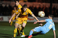 Plymouth's Conor Hourihane (6) is tackled by Newport's Kevin Feely (l) Skybet football league two match, Newport county  v Plymouth Argyle at Rodney Parade in Newport, South Wales on Tuesday 8th April 2014.<br /> pic by Andrew Orchard, Andrew Orchard sports photography.