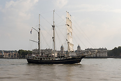 © Licensed to London News Pictures. 15/06/2016. LONDON, UK.  The historic tall ship,  Thalassa is seen passing the Old Royal Naval College on the River Thames in Greenwich. The Sail Royal Greenwich Tall Ship Festival runs until this Sunday, 18th Septmeber.  Photo credit: Vickie Flores/LNP
