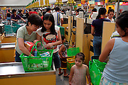 Supermarket shoppers checking out at the Pure Gold Grocery Store in Manila, Philippines. (Supporting image from the project Hungry Planet: What the World Eats)