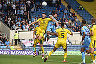 Coventry City defender Jordan Willis (4) heads the ball just over during the EFL Sky Bet League 1 match between Oxford United and Coventry City at the Kassam Stadium, Oxford, England on 9 September 2018.
