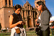 PERU, HIGHLANDS, CUZCO Plaza de Armas; Peruvian students