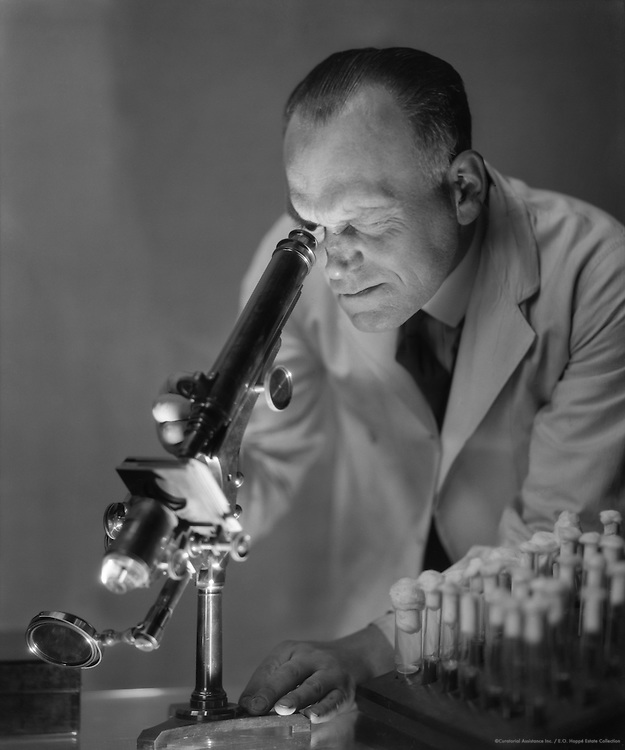 Mr. Bisping; chemist; looking through a microscope, 1931