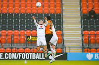 Football - 2020 / 2021 Emirates FA Cup - Round 2 - Barnet vs Milton Keynes Dons - The Hive<br /> <br /> Ephron Mason-Clark (Barnet FC) sandwiched between two Milton kynes defenders as he attempts to head the ball<br /> <br /> COLORSPORT/DANIEL BEARHAM