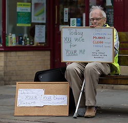 © Licensed to London News Pictures . 05/06/2014 . Newark , Nottinghamshire , UK . Man outside the UKIP office on Bridge Street in Newark today (Thursday 5th June 2014) as voting takes place in the Newark by-election , following the resignation of incumbent Patrick Mercer . Photo credit : Joel Goodman/LNP