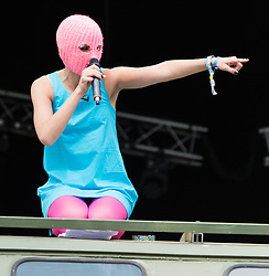 © Licensed to London News Pictures. 26/06/2015. Pilton, UK.  Members of Pussy Riot at Glastonbury Festival 2015 on Friday Day 3 of the festival on the Park Stage.  The members stage a struggle with a man in a balaclava symbolising oppression on top of an army truck, before being having a talk with Charlotte Church.  In this picture - Nadezhda Tolokonnikova.  This years headline acts include Kanye West, The Who and Florence and the Machine, the latter being upgraded in the bill to replace original headline act Foo Fighters.   Photo credit: Richard Isaac/LNP