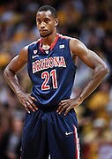 SHOT 1/21/12 5:30:41 PM - Arizona's Kyle Fogg #21 during a break in the action against Colorado in their PAC 12 regular season men's basketball game at the Coors Events Center in Boulder, Co. Colorado won the game 64-63..(Photo by Marc Piscotty / © 2012)