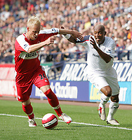 Photo: Andi Thompson.<br />Bolton Wanderers v Middlesbrough. The Barclays Premiership. 16/09/2006.<br />Boro's Andrew Davies (L) pushes away Bolton's El Hadji Diouf.