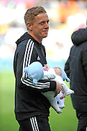 Swansea city manager Garry Monk with his twins walks around the pitch at the end of the match. Barclays Premier league match, Swansea city v Southampton at the Liberty stadium in Swansea, South Wales on Saturday 3rd May 2014.<br /> pic by Phil Rees, Andrew Orchard sports photography.