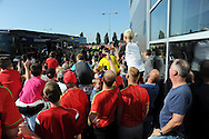 Wales fans watch as the Wales team bus arrives, catching a glimpse of Ben Davies as he gets off the bus outside the stadium before k/o. . Euro 2016 qualifying match, Wales v Israel at the Cardiff city stadium in Cardiff, South Wales on Sunday 6th Sept 2015.  pic by Andrew Orchard, Andrew Orchard sports photography.