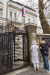 People outside the public entrance to the Russian Embassy on Notting Hill Gate as 23 Russian diplomats and their families prepare to leave the Russian embassy in London following their expulsion in the wake of the Salisbury poisoning case which has former spy Sergei Skripal and his daughter who remain in hospital in critical condition. . London, March 20 2018.