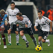 Besiktas's Simao SABROSA (R), Jose Maria Gutierrez HERNANDEZ (Guti) and Trabzonspor's Ibrahima YATTARA (L) during their Turkey Cup Group B matchday 5 soccer match Besiktas between Trabzonspor at the Inonu stadium in Istanbul Turkey on Wednesday 26 January 2011. Photo by TURKPIX