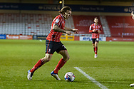 Lincoln City Midfielder Harry Anderson (26) qttacks during the EFL Sky Bet League 1 match between Lincoln City and Shrewsbury Town at Sincil Bank, Lincoln, United Kingdom on 15 December 2020.