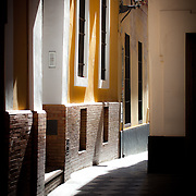 Image of the morning sun beaming through an alley in Seville, Spain.